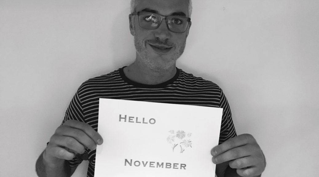 Man holding November sign
